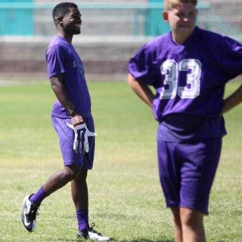 Silverado's Vernon Jackson, left, walks the field during practice at Silverado High School in Las Vegas on Monday, August 10, 2015. ERIK VERDUZCO/LAS VEGAS REVIEW-JOURNAL Follow him