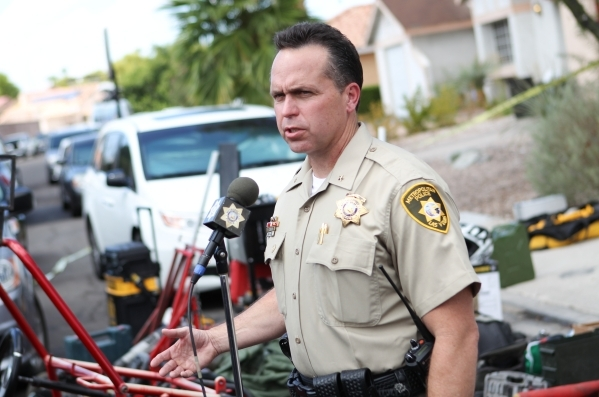 Las Vegas Deputy Chief Tom Roberts speaks as police investigate the home belonging to brothers Hugo and Frances Carbajal, who were both arrested on felony burglary charges, near Paradise and Warm  ...