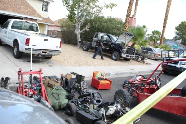 Las Vegas police say they have arrested suspects in a string of auto thefts and ramming of police vehicles. Stolen equipment is shown on ground.(Chase Stevens/Las Vegas Review-Journal) Follow Chas ...
