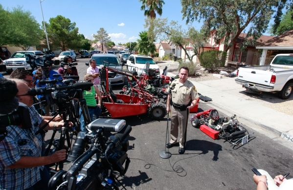 Metro Deputy Chief Tom Roberts speaks as police investigate the home near Paradise and Warm Springs roads belonging to brothers Hugo and Frances Carbajal, who were both arrested on felony burglary ...