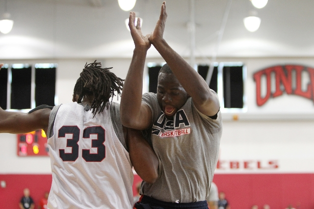 USA Basketball Men's National Team players Draymond Green, right, and Kenneth Faried, share a moment during a mini-camp practice at the Mendenhall Center on the UNLV campus in Las Vegas Tues ...