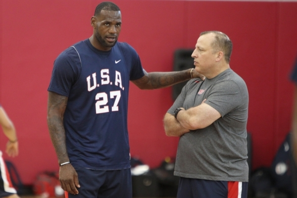 Assistant coach Tom Thibodeau chats with LeBron James during USA Basketball's minicamp practice Wednesday at UNLV's Mendenhall Center. Thibodeau was fired by the Chicago Bulls in May a ...