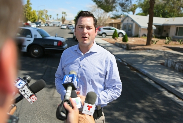 Public Information Officer Jesse Roybal speaks to the news media about an officer-involved shooting at the 6900 block of Berkshire Place Friday, Aug. 7, 2015, in Las Vegas. Police checking reports ...