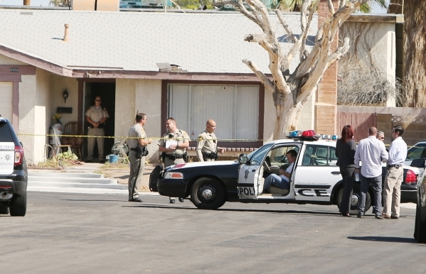 Las Vegas police investigate an officer-involved shooting in the southwest valley in the 6900 block of Berkshire Place, near the intersection of Rainbow Boulevard and Tropicana on Friday, Aug. 7,  ...