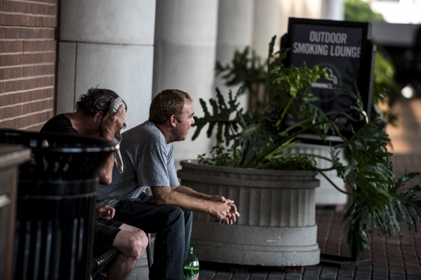 Smokers sit in an outdoor smoking lounge at Harrah's in New Orleans on Tuesday, Aug. 11, 2015. (Joshua Dahl/Las Vegas Review-Journal)