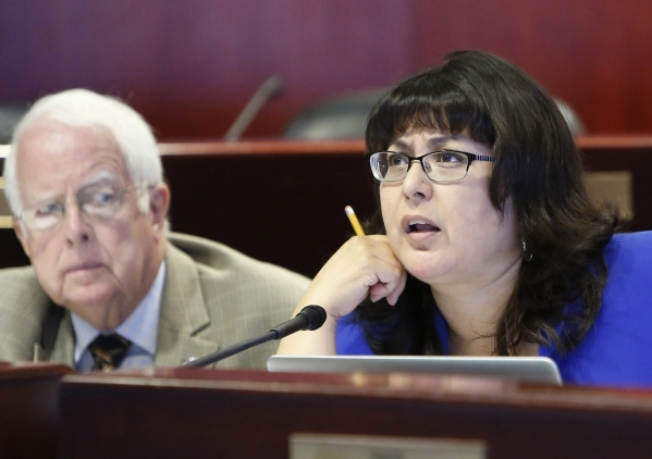 Assemblywoman Irene Bustamante Adams speaks during a legislative hearing on Uber-related legislation as Assemblyman Lynn Stewart, left, looks on at Grant Sawyer Building Monday, Aug. 10, 2015. BIZ ...