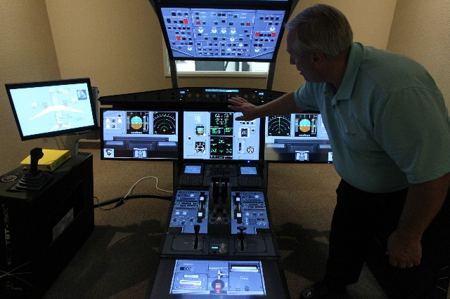 Bob Lieser, director of pilot training for Allegiant Air, shows the inside of an A320 Multi-function Flight Training Device at the newly opened Allegiant Air Training Center in Las Vegas Tuesday,  ...