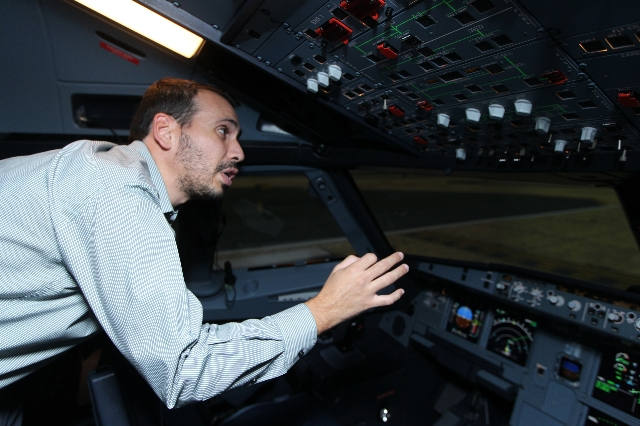 Jose Diaz, air bus fleet manager for Allegiant Air, shows the inside of an A320 Multi-function Flight Training Device at the newly opened Allegiant Air Training Center in Las Vegas Tuesday, Aug. 1 ...