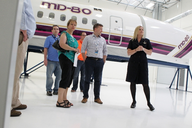 Beatrice Burgos, far right, flight attendant and field instructor for Allegiant Air, gives a tour of the newly opened Allegiant Air Training Center in Las Vegas Tuesday, Aug. 11, 2015. ERIK VERDUZ ...