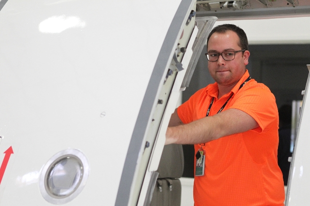 Levi Witthuhn, manager of inflight safety management systems for Allegiant Air, tours the newly opened Allegiant Air Training Center in Las Vegas Tuesday, Aug. 11, 2015. ERIK VERDUZCO/LAS VEGAS RE ...