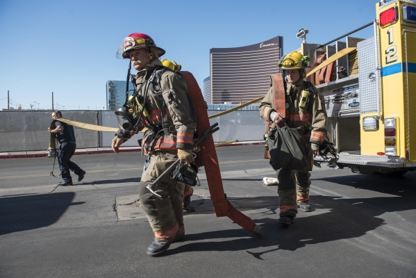 Crews from both the Clark County and Henderson Fire Departments participate in a joint high-rise firefighting exercise at the site of the now closed Riviera hotel-casino in Las Vegas on Monday, Au ...