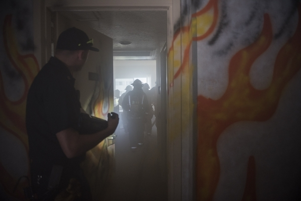 Flames are painted on the walls of the closed Riviera to indicate fire during a joint Clark County and Henderson high-rise firefighting exercise Monda. (Martin S. Fuentes/Las Vegas Review-Journal)