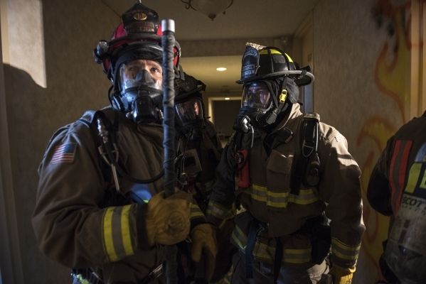 Crews from the Clark County and Henderson fire departments participate in a joint high-rise firefighting exercise at the closed Riviera on Monday. (Martin S. Fuentes/Las Vegas Review-Journal)
