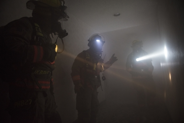 Crews from the Clark County and Henderson fire departments participate in a joint high-rise firefighting exercise at the now closed Riviera on Monday. (Martin S. Fuentes/Las Vegas Review-Journal)