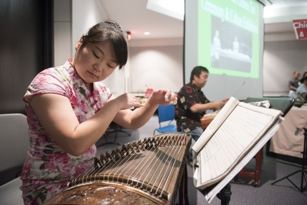 Yun Peng plays the Guzheng during the Chinese Tea Ceremony & Culture Exhibition at Sahara West Library in Las Vegas, Saturday, Aug. 8, 2015. (Jason Ogulnik/Las Vegas Review-Journal)
