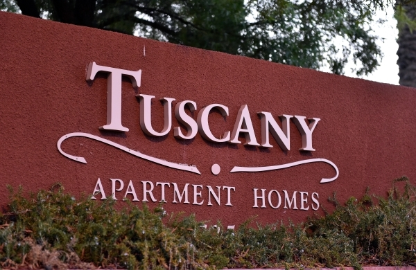 The Tuscany Apartment Homes sign is seen on Monday, Aug. 10, 2015. Las Vegas police investigated a double shooting at the apartments along Hualapai Way just south of Charleston Boulevard in Summer ...