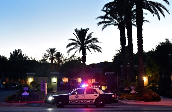 Las Vegas police investigate a double shooting at the Tuscany Apartment Homes along Hualapai Way just south of Charleston Boulevard in Summerlin on Monday, Aug. 10, 2015. Two people died, police s ...