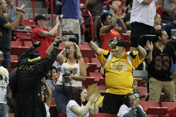 Arena football fans celebrate a touchdown by the Outlaws against the Cleveland Gladiators on June 7 at the Thomas & Mack Center. ERIK VERDUZCO/LAS VEGAS REVIEW-JOURNAL / FOLLOW HIM
