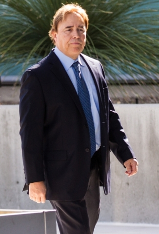 Urologist Michael Kaplan walks toward the Lloyd George U.S. Courthouse on Tuesday morning, May 5, 2015.  Kaplan, who was sentenced to four years in federal prison for his conviction for reusing eq ...