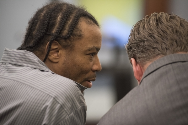 Defendant Lesean Collins, accused of the 2008 murder of Brandi Payton, speaks to his attorney Michael Hyte during the closing arguments of his case from the Regional Justice Center in Las Vegas on ...