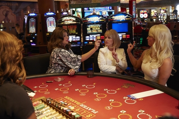 """From left, Casey Wilson, Angela Kinsey and Andrea Savage appear in a scene from Hulu's """"The Hotwives of Las Vegas."""" (Courtesy Hulu)"""