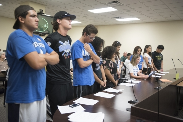 Arlene Kam, a science teacher at Sierra Vista High School, is joined by 10 of her students as she speaks during a meeting at the Public Utilities Commission West Diablo Road office in Las Vegas, W ...