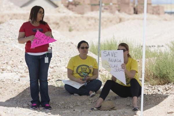 Rooftop solar advocates and workers rally outside of the Public Utilities Commission West Diablo Road office in Las Vegas, Wednesday, Aug. 12, 2015. (Jason Ogulnik/Las Vegas Review-Journal)