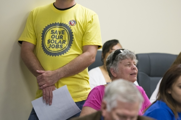"""A shirt reading """"save our solar jobs"""" is shown during a meeting at the Public Utilities Commission West Diablo Road office in Las Vegas, Wednesday, Aug. 12, 2015. (Jason Ogulnik/Las Vega ..."""