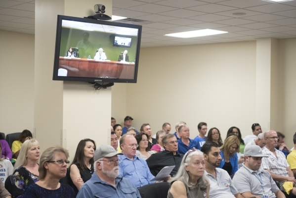 A screen broadcasting a meeting at the Public Utilities Commission office in Carson City is shown at the meeting at the PUC West Diablo Road office in Las Vegas, Wednesday, Aug. 12, 2015. (Jason O ...