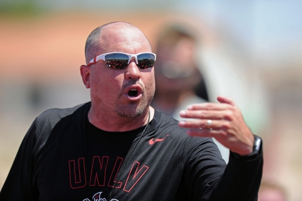 First-year UNLV football coach Tony Sanchez, seen instructing his players during an intrasquad scrimmage on Aug. 15, 2015. (Josh Holmberg/Las Vegas Review-Journal)