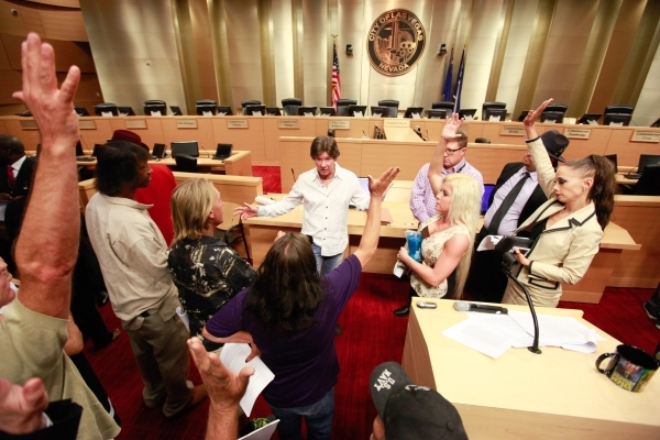 Las Vegas City Attorney Brad Jerbic speaks to a group of people about the Fremont Street performer ordinance at Las Vegas City Hall on Tuesday, Aug. 11, 2015. The proposed draft would require stre ...