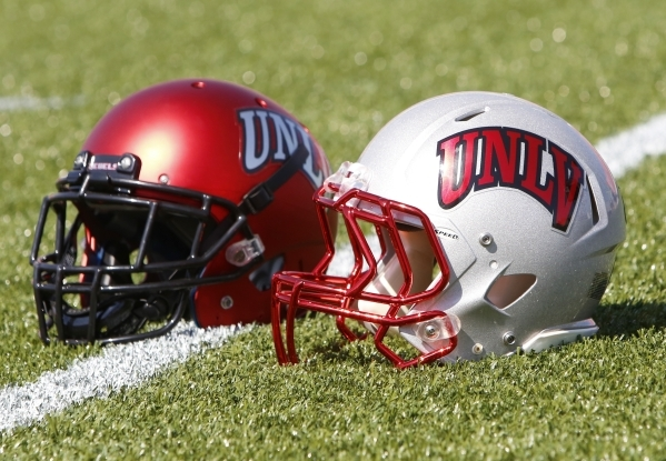 The UNLV Rebels football team's new helmets are seen during UNLV football media day at Sam Boyd Stadium on Thursday, Aug. 13, 2015. (BIZUAYEHU TESFAYE/LAS VEGAS REVIEW-JOURNAL)
