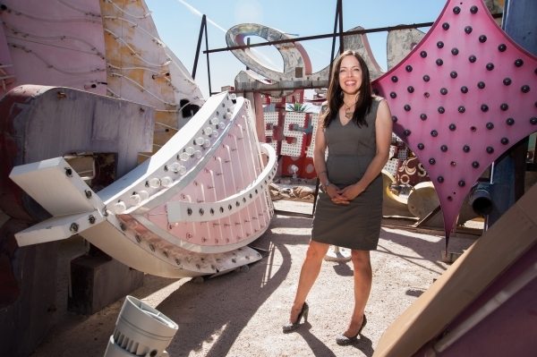 Neon Museum executive director Danielle Kelly — who's leaving Las Vegas and moving to Las Vegas, N.M., with her family — poses for a portrait inside the museum's boneyard. (Martin  ...