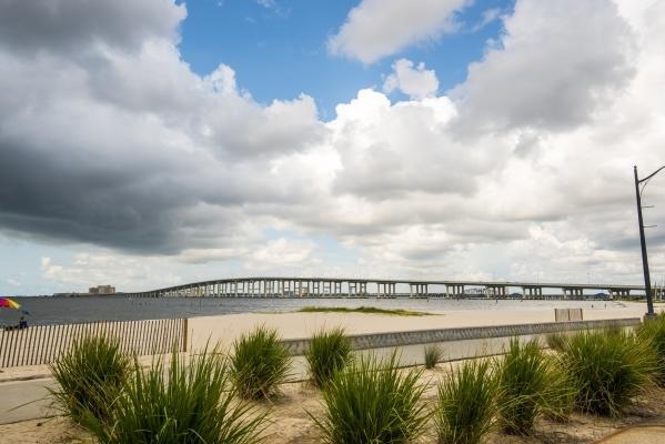The Ocean Springs-Biloxi Bridge is seen from Front Beach in Ocean Springs, Miss., in mid-August. (Joshua Dahl/Las Vegas Review-Journal)
