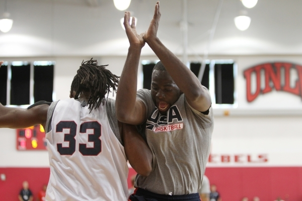 USA Basketball Men's National Team players Draymond Green, right, and Kenneth Faried, share a moment during a mini-camp practice at the Mendenhall Center on the UNLV campus in Las Vegas Tuesday, ...