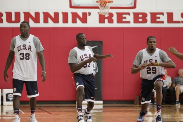 USA Basketball Men's National Team players from left, Victor Oladipo, Draymond Green, and Kevin Durant, stretch during a mini-camp practice at the Mendenhall Center on the UNLV campus in Las ...