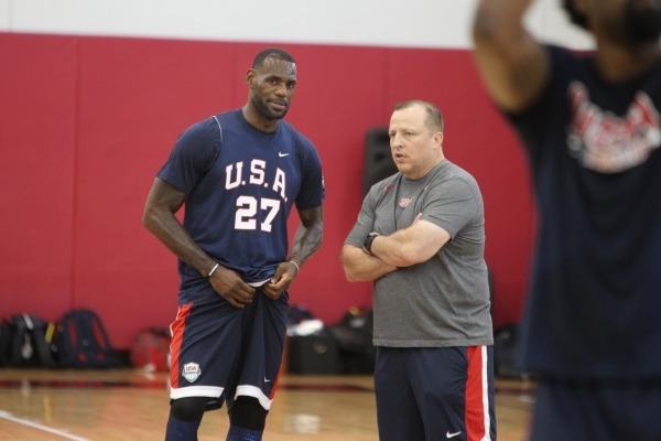 USA Basketball Men's National Team player Lebron James, left, and assistant coach Tom Thibodeau, speak to each other during a mini-camp practice at the Mendenhall Center on the UNLV campus i ...