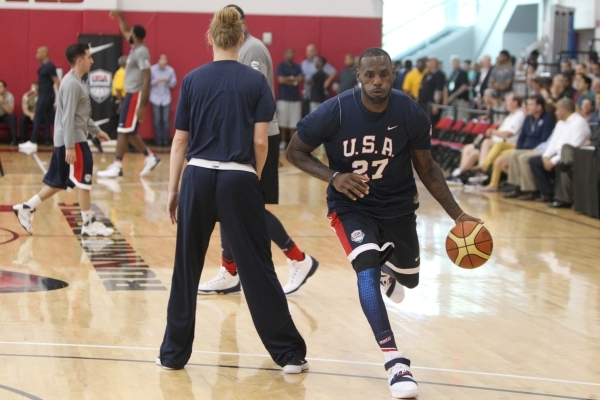 USA Basketball Men's National Team player Lebron James drives the ball to the basket for a shot during a mini-camp practice at the Mendenhall Center on the UNLV campus in Las Vegas Wednesday ...