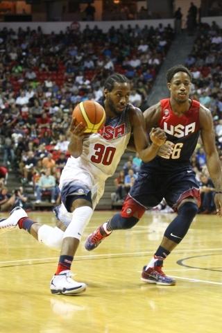 Kawhi Leonard (30) drives past DeMar DeRozan (26) during the USA Basketball Showcase game at the Thomas & Mack Center in Las Vegas on Thursday, Aug. 13, 2015. CHASE STEVENS/LAS VEGAS REVIEW-JO ...