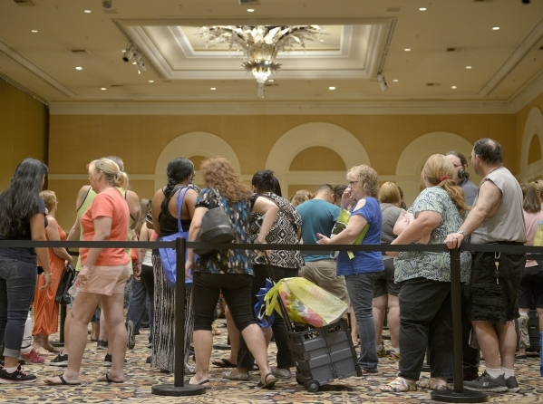 Thousands of Clark County School District teachers wait in line for free school supplies donated by MGM Resorts employees at The Mirage in Las Vegas on Thursday, Aug. 13, 2015. The school supply d ...
