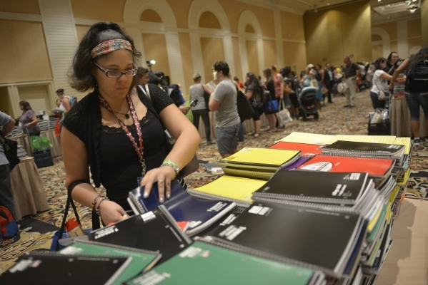 Daisy Hernandez from Jack Dailey Elementary School and thousands of Clark County School District teachers look through school supplies donated by MGM Resorts employees at The Mirage in Las Vegas o ...