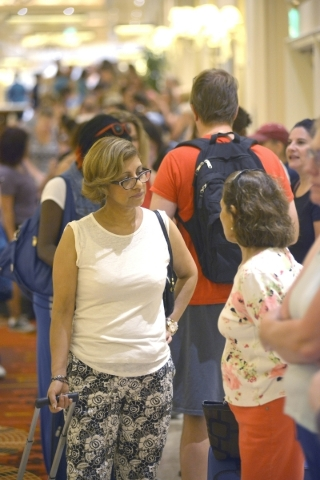 Veronica Angelo, left, of Hinman Elementary School and Veronica Angelo of Cheyenne High School wait in line with thousands of Clark County School District teachers for free school supplies donated ...