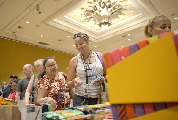 Misha Lum, left, and Kinshasa Hill, both from Park Elementary School, along with thousands of Clark County School District teachers, look through school supplies donated by MGM Resorts employees a ...