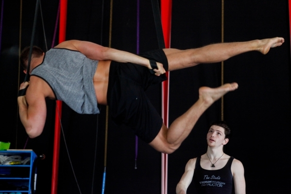 "Aerial choreographer Brandon Hansen watches Cory Lloyd rehearse for Super Summer Theatre's production of ""Tarzan: The Musical."" (James Tensuan/Las Vegas Review-Journal)"