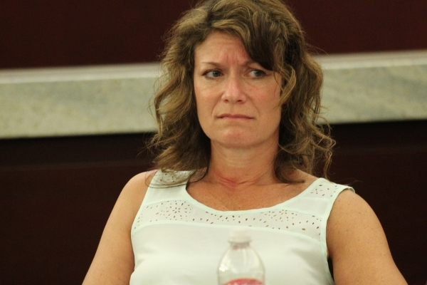 Private attorney Elyse Tyrell listens during public comment in the second meeting of the Nevada Supreme Court Panel on Guardianship at the Regional Justice Center in Las Vegas Monday, Aug. 17, 201 ...