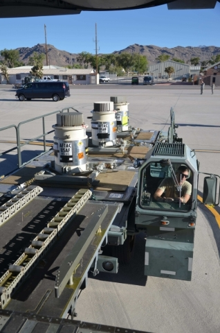 Three radioisotope thermoelectric generators belonging to the Air Force Technical Applications Center, Patrick AFB, Fla., are downloaded from an Air Force C-17 Globemaster III onto a 25K loader at ...