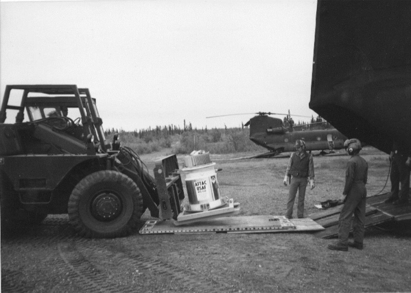 The original radioisotope thermoelectric generator is downloaded from a helicopter at Burnt Mountain, Alaska, 60 miles north of the Arctic Circle, circa 1973. The generator was once used as a powe ...