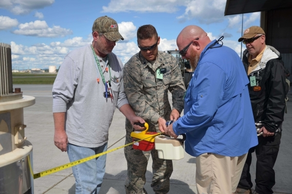 From left, Chris Anthony, Lt. Col. Clint Abell, and Charlie Mitchell conduct radiation dose rate measurements using an ion chamber as Air Force Technical Applications Center radiologic safety offi ...