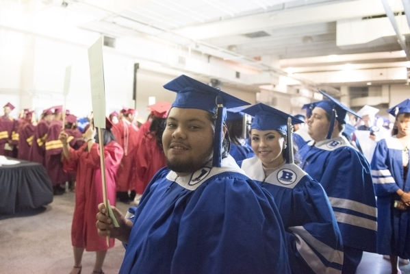 Basic High School graduates, Michael Del Rio and Lesley Garcia line up backstage during the Clark County School District's summer commencement ceremony at Orleans Arena in Las Vegas, Tuesday ...