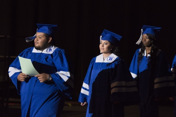 Basic High School graduates, Michael Del Rio, Lesley Garcia, and Brejon Grays prepare to take their seats during the Clark County School District's summer commencement ceremony at Orleans Ar ...